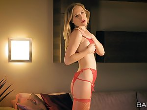 Venerated handles the toy in a sensual lingerie solo play