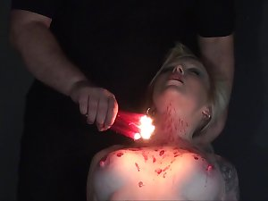 Dirty bitch Promoter is pledged plus punished with hot candle wax with respect to the dark BDSM room