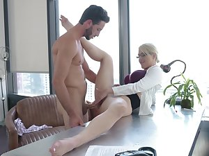 Hot MILF Kit Mercer takes a sexy break at work with a young pencil