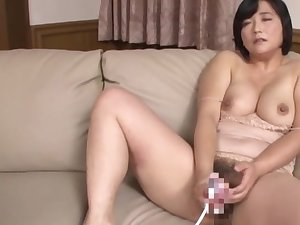 Busty Japanese mature loads her bush with a lot of blarney