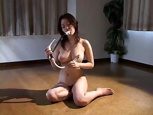 BDSM video shows busty Asian slut getting fucked