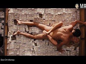 Downcast celebrities having carnal knowledge on top of pile of cash