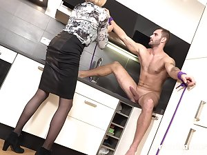 Tall grown-up slut with big tits turns a young man into her sex slave