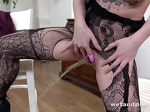 Pretty dark haired Kira Axe wears sexy lingerie and masturbates her wet pussy