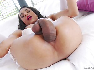 Nasty shemale Melissa Pozzi with a giant dick enjoys masturbating